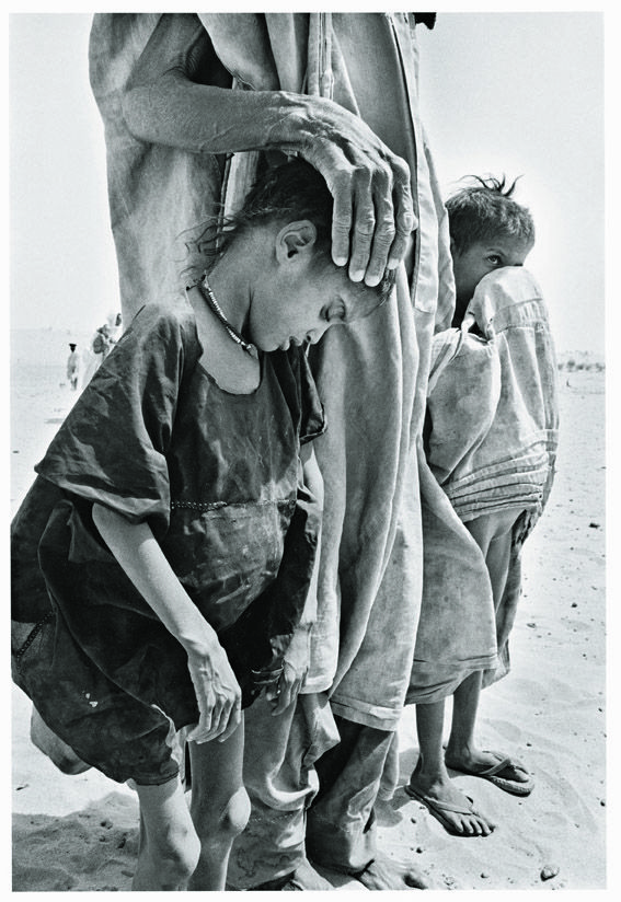 Sebastiao Salgado, Africa - despite drought, famine, there is a mother (or father), an adult to hold these children close