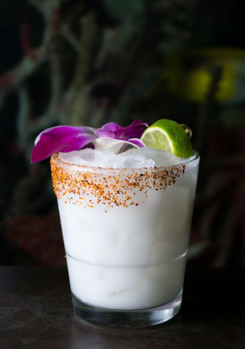 Recipe:  1.5 oz Milagro Tequila  1 oz Coco Lopez cream of coconut  .5 lime juice  Directions:  Combine all ingredients and shake over ice. Serve with a salted or spiced rim.  From Fishbowl at Dream Midtown in New York City