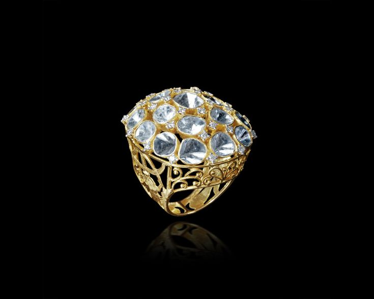 This resplendent cocktail ring, beautifully crowned with an assemblage of uncut diamonds, is a perfect standalone accessory for a glamorous look!