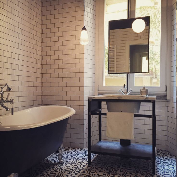 beautiful bathroom in central Milan, cement tiles, old bath tub, iron custom-made sink, calacatta marble design by Nomade Architettura http://www.nomadearchitettura.com/