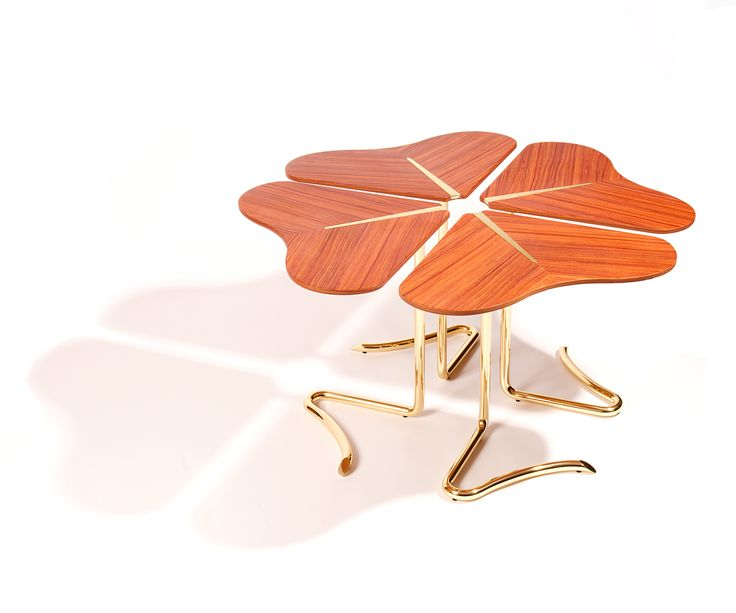 Four… for Luck center table by Joana Santos Barbosa for INSIDHERLAND  #table #rosewood #clover #fourleafclover #luck #furniturecollection #furnitureinspiration #entrance #home #table #interiorideas #brass #brasstable #natureinspiration #nature #furniture #uniquedesign #interiordecor #interiors #designtrends #organicdesign #uniquedesign #insidherland #jsb