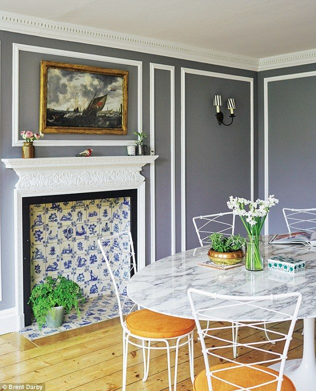 The walls are painted in Farrow & Ball Lamp Room Gray (farrow-ball.com) with the panelling details highlighted in Dulux Trade white (dulux.co.uk). The classic Eames Tulip marble-top table is teamed with vintage 1950s garden chairs bought in France