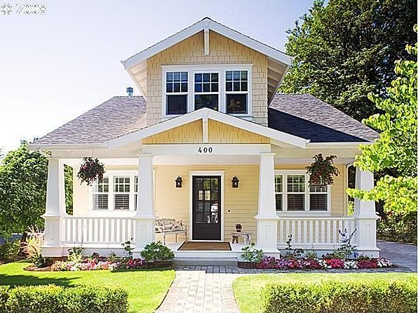 pale yellowcream body white trim and white painted porches dark front door craftsman style exteriorcraftsman columnscraftsman cottagecottage