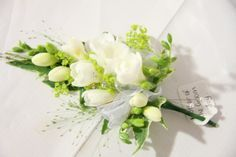 corsages for the mother of the groom | white freesia corsage for the mother of the groom