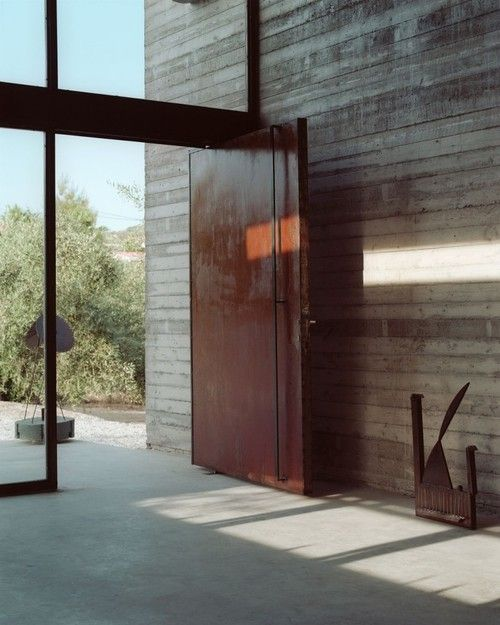 old wood, rustic steel door, and black steel frame