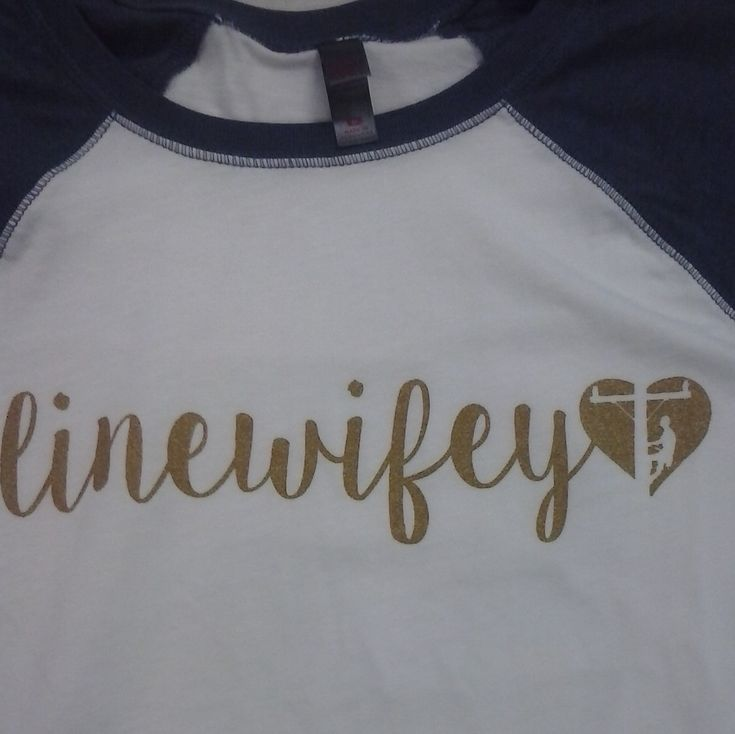 "This ""linewifey"" baseball tee is a must for fall! This 3/4 sleeve raglan shirt in heathered navy  features a metallic gold print with the signature Lineman Love Supply Co.™heart. Support your hubby in style! Cotton/Poly blend."