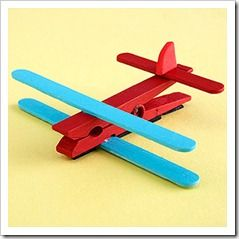 or each airplane, paint one clothespin, 2 popsicle sticks and 1 mini popsicle stick. Let dry. (We just colored the pieces with crayons so we didn't have to wait for them to dry!) Glue one wing to the top and one to the bottom of the clothespin. NOTE: I like to use hot glue because it dries quickly and is strong. If you want the kids to use regular glue, it may have to dry overnight. Glue the mini craft stick to the back of the clothespin. Cut a small tail wing from foam craft paper and glue…