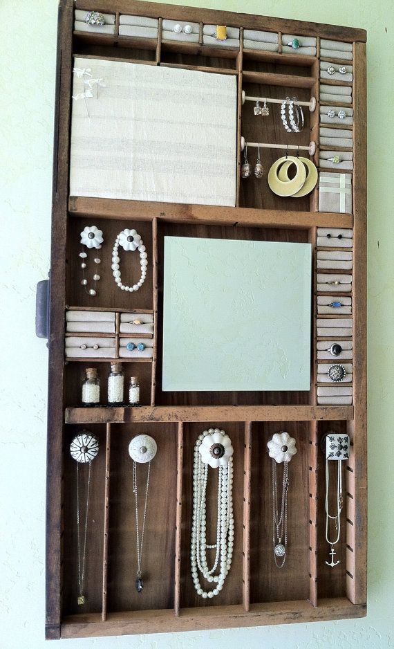 What a great way to organize and display your jewelry! Jewelry Organizer Made From A Wood Antique Printing Tray by Mowgis
