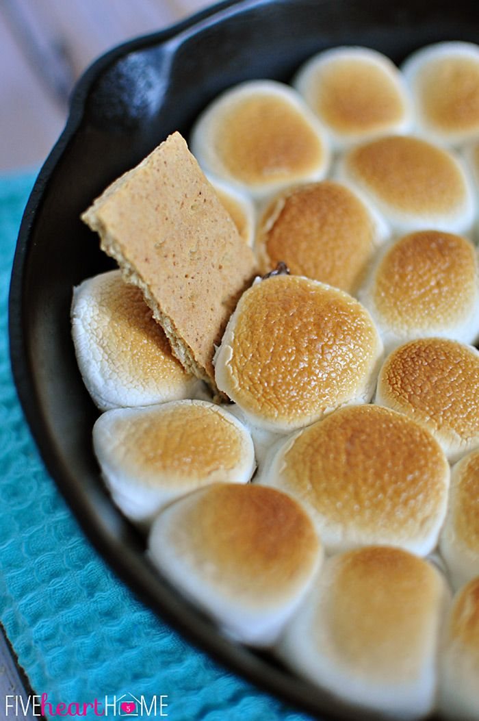 S'mores Dip ~ melted chocolate and toasty marshmallows bake up in a skillet; scoop up with graham crackers for a perfect party dessert! | Fi...