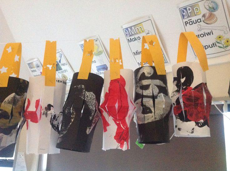 Make paper lanterns with maori symbols painted on.