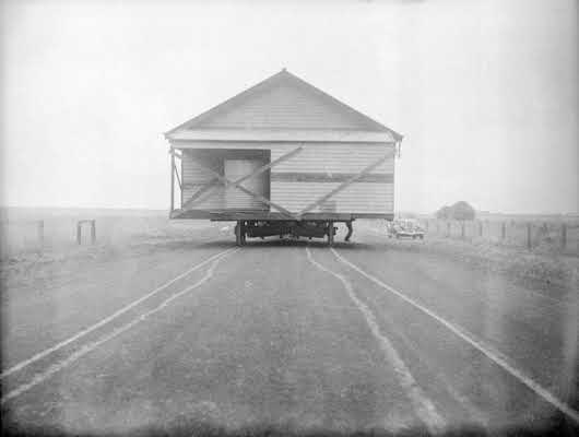 1930 House being moved on the Princes Highway, Victoria. VicRoads. Centenary 1913-2013.