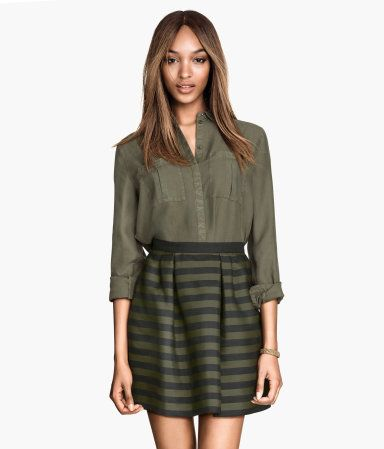 Short, flared skirt in woven fabric with a sheen. Pleats at front, concealed zip at back. Unlined.   H&M US