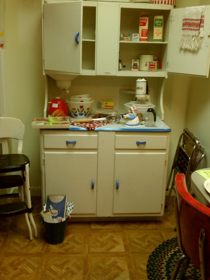 When I was small, we had these type of stand-alone cupboards in our kitchen. We had two. Vintage 1940's Sellers Hoosier with blue handles and trim