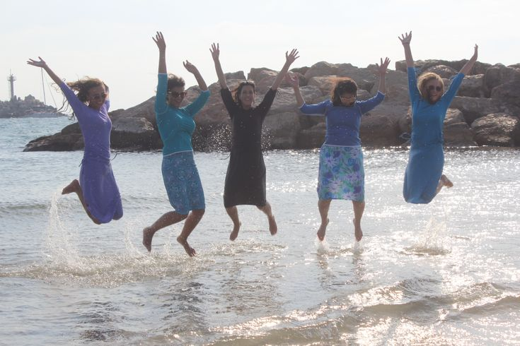 We love jumping for joy in our Aqua Modesta original modest swimwear! Use coupon code: LOVE and enjoy special savings