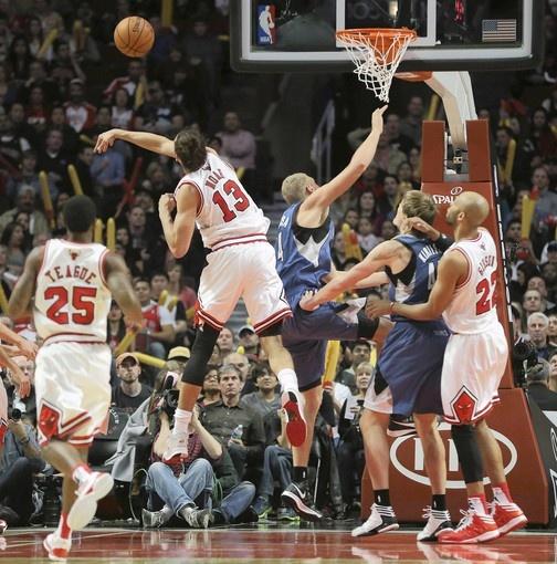 Joakim Noah blocks the shot of the Timberwolves' Greg Stiemsma in the second half.
