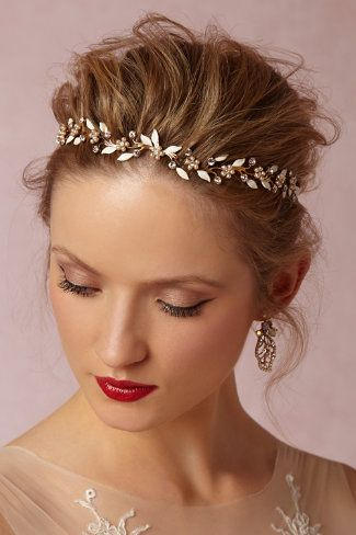 Gold hairband for the bride.
