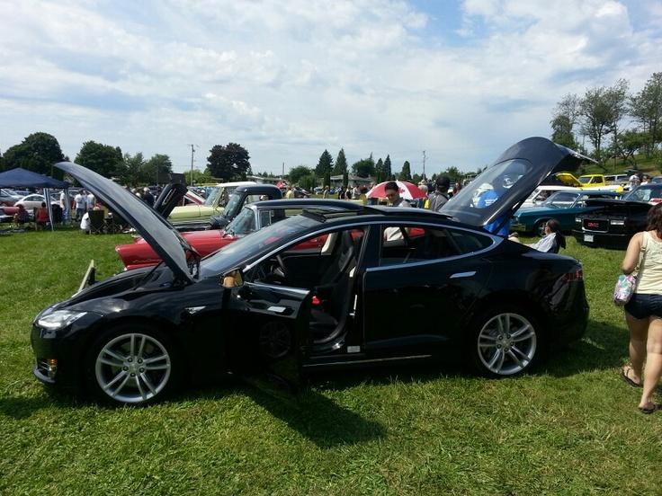 An electric car id own. Tesla.
