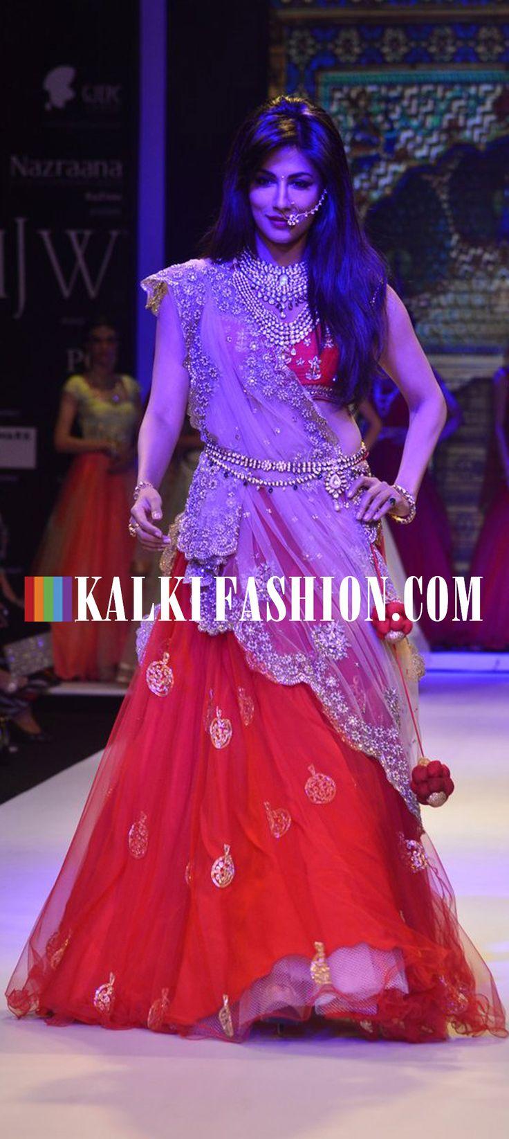 Chitrangda Singh walked the ramp for Moni Agarwal in red and beige bridal lehenga at India International Jewellery week 2014. http://www.kalkifashion.com/