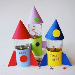 Make rocket globes using water bottles, glitter, and construction paper.