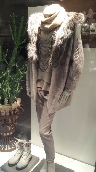 Italian Autumn fashions for women.Beige Faux fur collared cardigan outfit comprising of woolen scarf,slim fit beige trousers and beige leather boots.