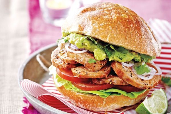 Cemita-Style Pork Sandwich - This popular Latin-style street food is traditionally served on a bun called a cemita, which is a sesame-topped egg bread. Luckily, you don't have to travel to try this tasty concoction: Here we use challah, which is similar to cemita and more readily available. Marinating in spices and lime juice gives the meat a spicy kick, which is offset by a cool guacamole spread.