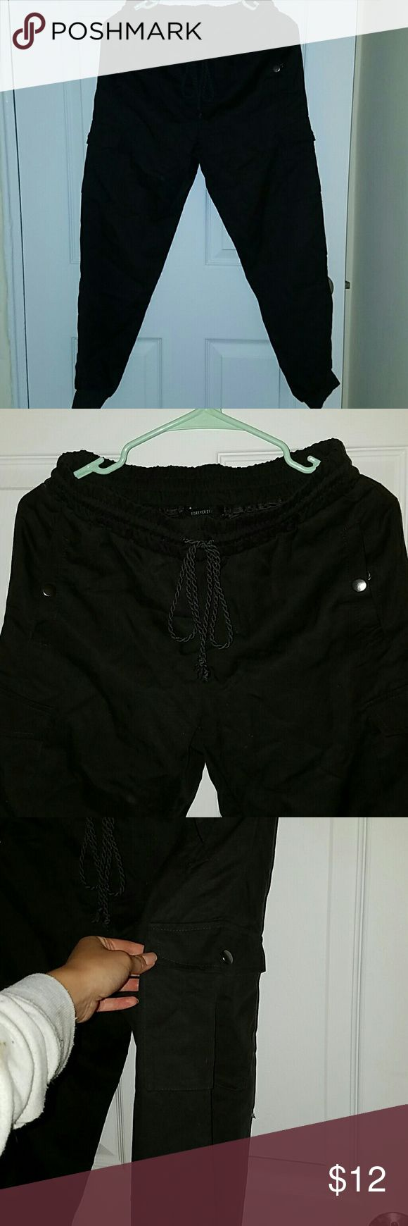 Jogger cargo pants Dark gray/dark brown jogger pants from forever 21. Loose fit, very comfortable material. Cargo pockets on the side. Tie front. Used once. Forever 21 Pants Track Pants & Joggers
