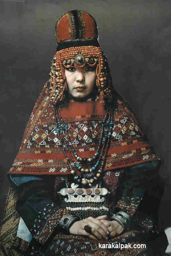 The Karakalpak kiymeshek is a woman's head veil, which covers the hair and uppermost part of the body but leaves the face exposed. It was always worn with a matching turban. It is an integral garment, immediately recognizable by its embroidered triangular front and its diamond-shaped shawl at the back