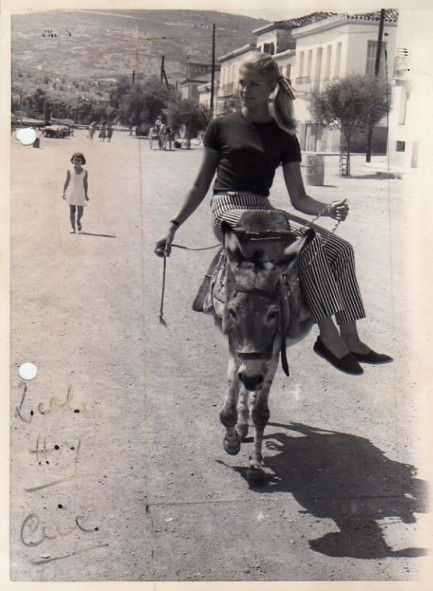 """Candice Bergen rides a donkey through the streets of Galaxidi,Greece, during a break in filming 1966's """"The Day the Fish Came Out."""""""