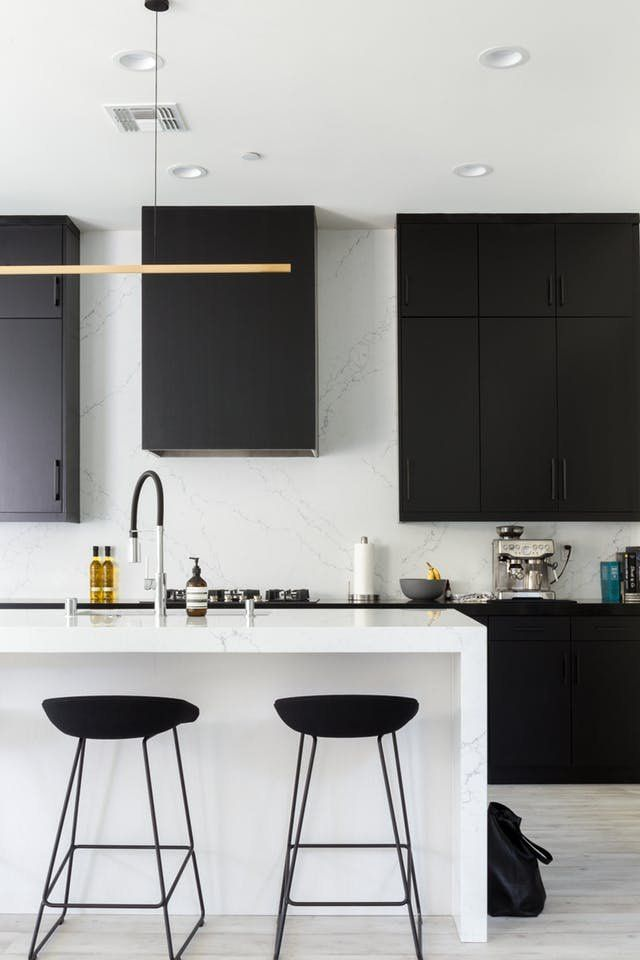 These Are Some of the Best, Boldest Uses of Black | Almost exclusively featuring a black and white color palette (with maybe a few wood tones), it's a gorgeous example of how to do a lot with a little. It's also FULL of bold ways to use the color black.