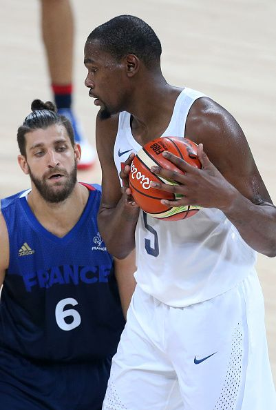 Kevin Durant of USA and Antoine Diot of France in action during the basketball…