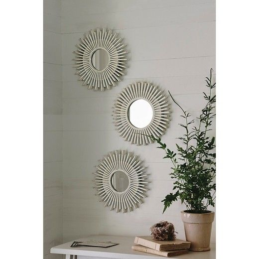 Give your indoor décor a burst of style with this Sunburst Gold Accent Mirrors - 3-pack - Threshold™. This mirror set includes three starburst-style pieces, each with a gorgeous washed wood finish. Mount these mirrors to one wall in a vertical or horizontal line, stagger them for a playful effect or divide them among many walls for a sunny theme throughout your space. Each wall mirror mounts flush to the wall and features a small round mirror in the center for the perfect gl...