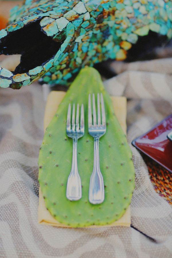 cactus leaf decor, photo by Gideon Photography http://ruffledblog.com/textured-wedding-inspiration #weddingideas #reception #placesetting