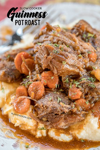 Slow Cooker Guinness Pot Roast - the BEST pot roast EVER! Pot roast, gravy mix, Italian dressing mix, tomato paste, carrots and potatoes. Put everything in the slow cooker and let it cook all day. Ser