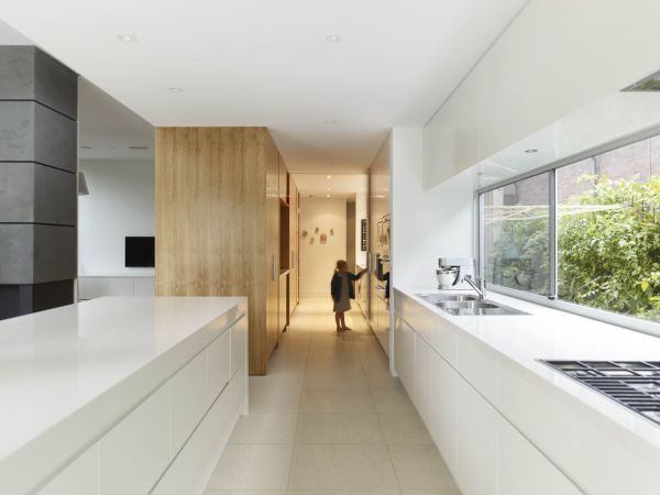 Minimalist open kitchen with large windows and a unique layout