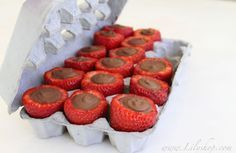 Chocolate filled strawberries, though I'd use dark chocolate instead of milk. Set them up in an egg carton while the chocolate dries.