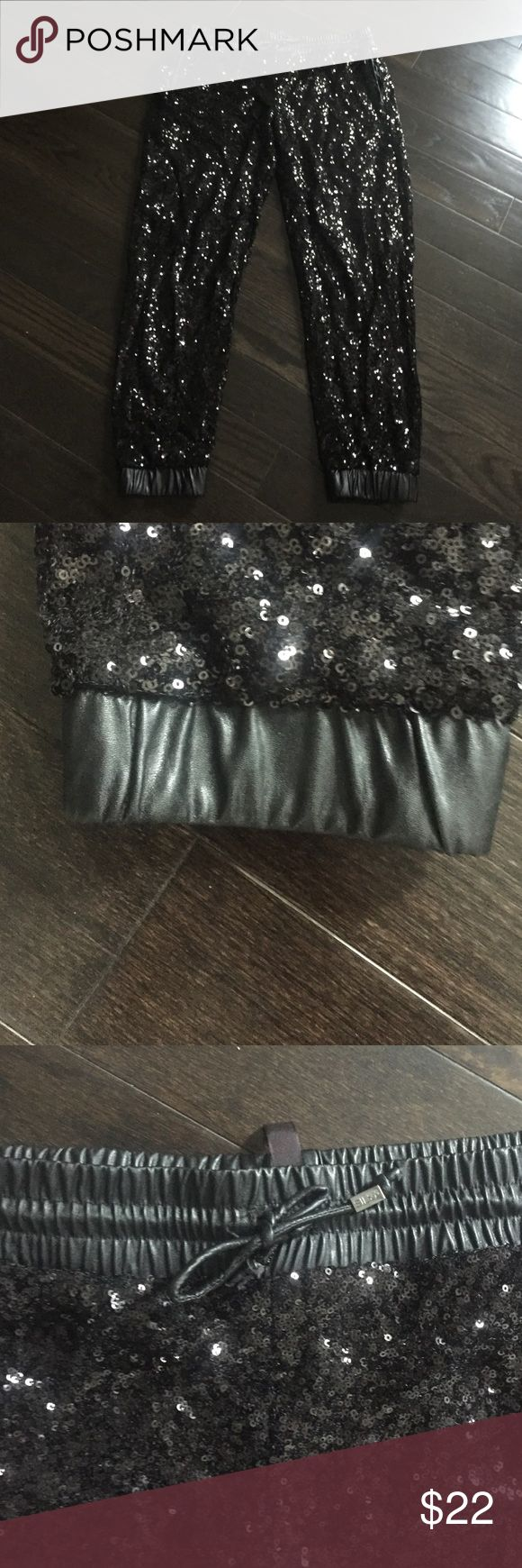 Sequin joggers black leather detail drawstring Black sequin joggers. Leather detail at ankles and at waist. Great condition only work 1x. Size M Pants