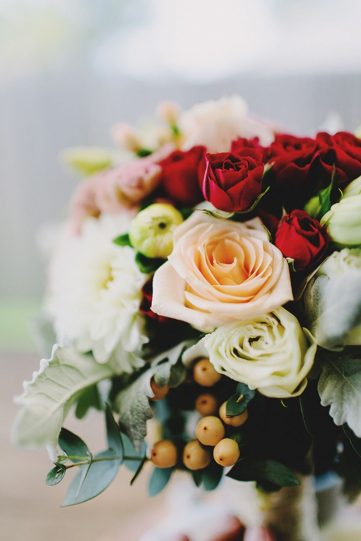 Wedding flowers by @thecopperpoppy1 in red, blush and peach tones with greenery and a spray of berries. www.summerdean.com.au