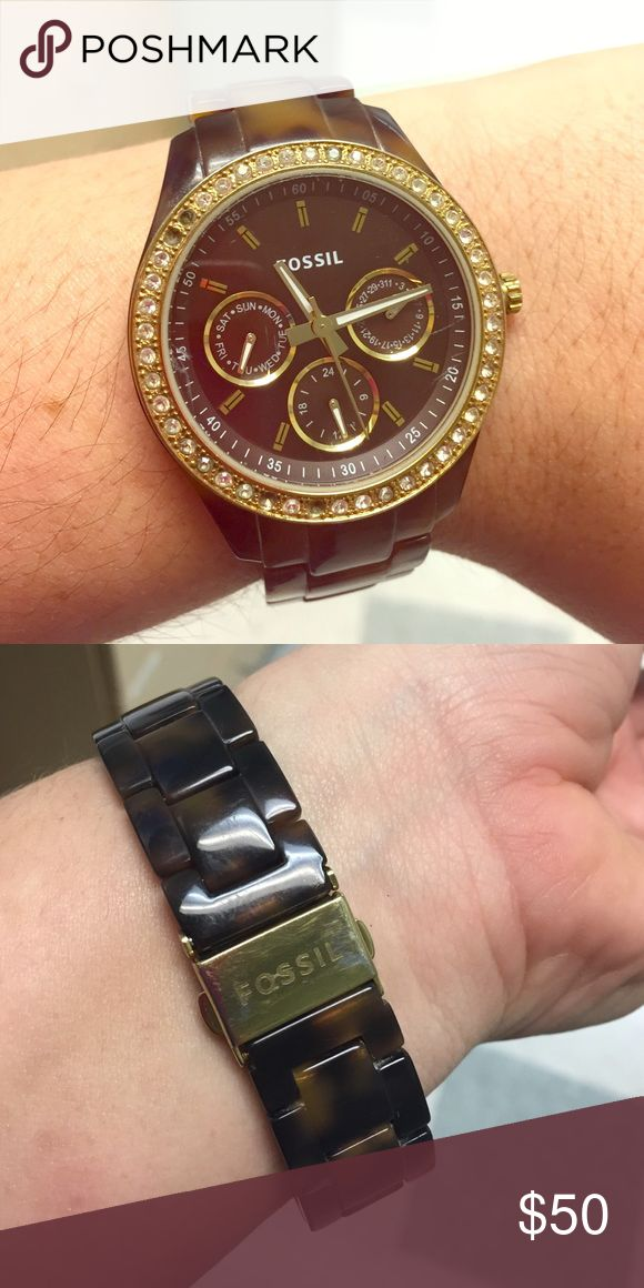 Tortoise shell resin Fossil watch Classy brown and tan tortoise shell Fossil watch. Battery replaced at Fossil last week. 4 small crystals missing, price reflects this. Chronograph face. Some wear on face. Adorable, everyday watch. Fossil Accessories Watches