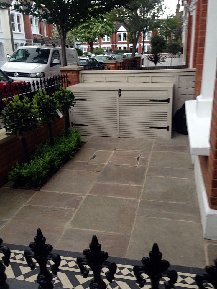 red brick front garden wall yellow stone caps sandstone paving victorian mosaic tile path chelsea west london