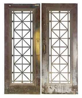 A PAIR OF AMERICAN PATINATED-BRONZE DOORS,
