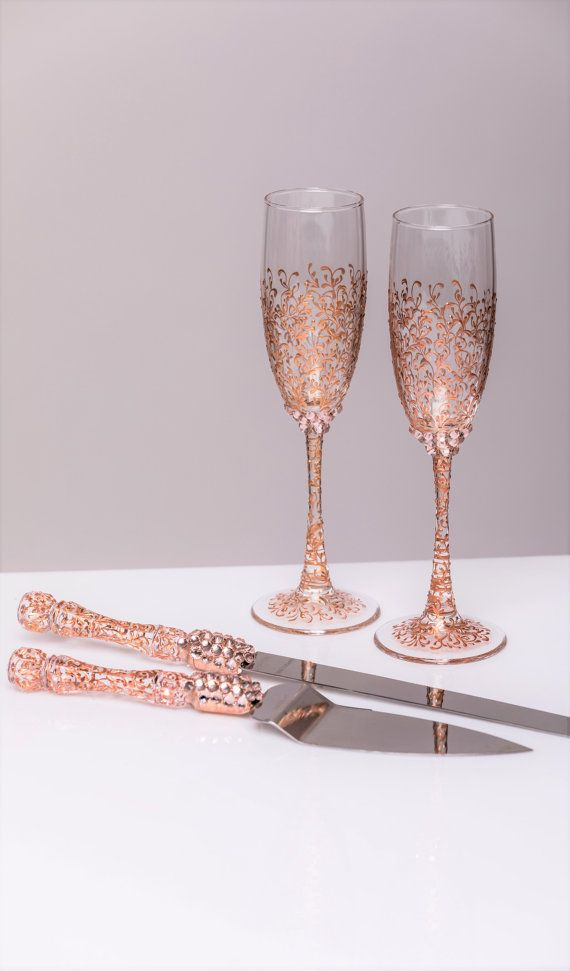 Gold Wedding сhampagne glasses and cake server and knife gold bride and groom set of 4 wedding toasting flutes personalized glasses  For these glasses color: rose gold All completely handmade! MEASUREMENTS: -Champagne flutes : Height - 9.2 inch (23.5 sm). Volume – 170ml (6.1 oz) - set for cake: cake server - 10 cake knife - 13  Custom champagne glasses may be created to fit your needs. Your unique wedding colors can be used for this design. Names and date may be painted to customize to your…