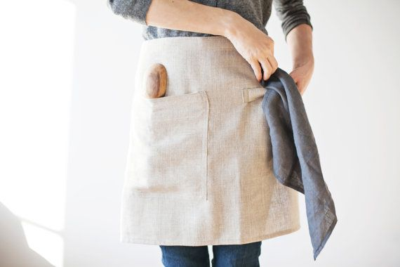 Linen café apron with spoon pocket and towel loop.