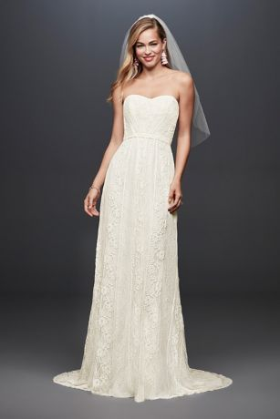 This strapless, linear lace wedding dress is just the gown for the free-spirited bride. The soft sheath silhouette flatters the figure, as an attached grosgrain ribbon accents the waistline. Galina,