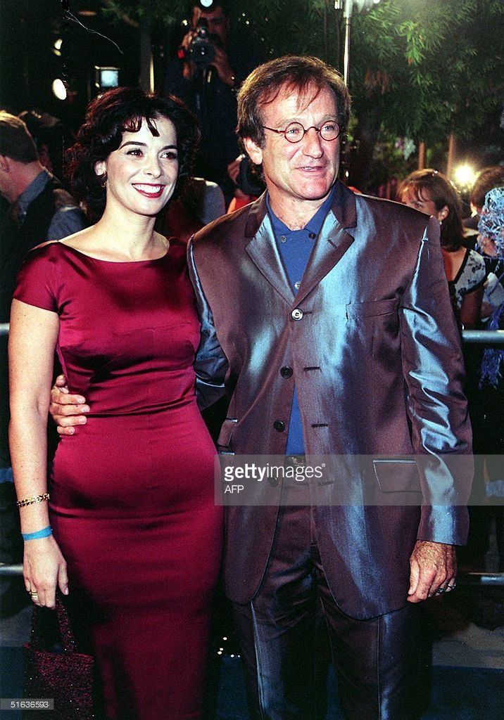 Actress Annabella Sciorra(L) and Academy Award winning actor Robin Williams(R) arrive for the premiere of their new film, 'What Dreams May Come' 28 September 1998 in Beverly Hills, CA. The film, a romantic-fantasy based on the Richard Matheson novel, tells of one man's journey to other worlds to find the woman he loves. AFP PHOTO Vince BUCCI