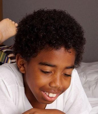 Medium Curls  Boys' hair can be left slightly longer for a more natural style than a sharp crop. Longer hair will tangle more easily, however, and it should be conditioned well to prevent snarls.