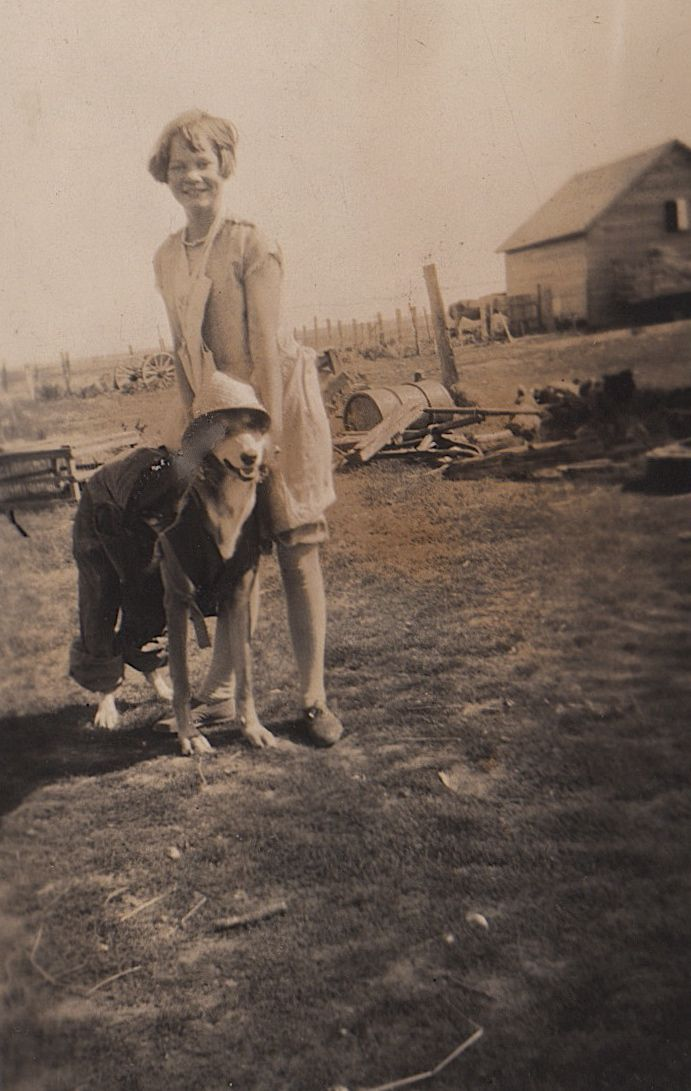 """Francis and Hound.  On the back:  """"This is typical of Frances has hound dressed up.  Probably should be washing dishes instead of this foolery.  I remember when I did it myself""""  Grandma Herring's writing"""