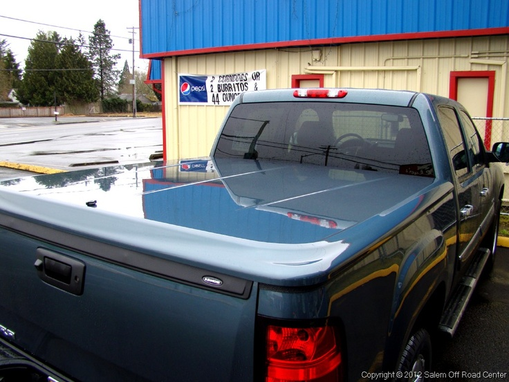 A 2011 Chevy 1500 with an UnderCover Tonneau Covers Lux painted to match cover. http://www.salemoffroadcenter.com/