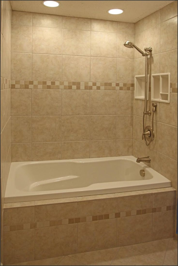 Bathroom shower lights - Love Everything In This Tub Insert Neutral Warm Tile With Accent Strips Shelf Small Bathroom Tilesbathroom Shower