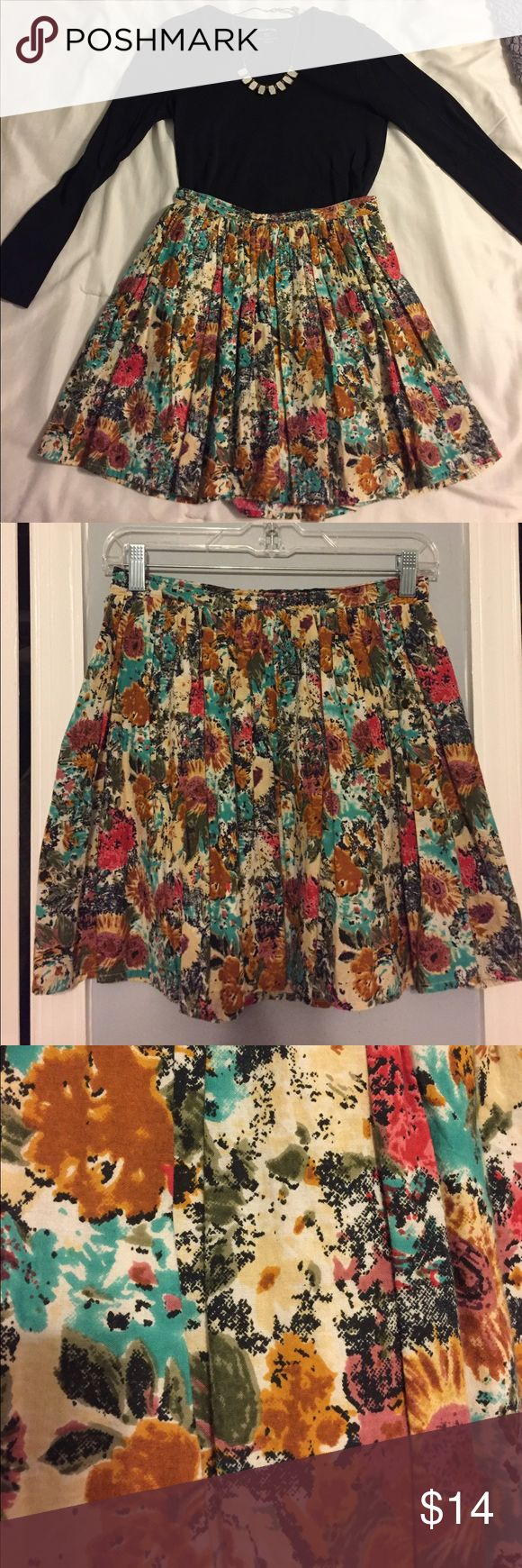 Floral flowly skirt This floral skirt was purchased at a local boutique. It pairs perfect with almost any color tee. Can be dressed up or dressed down. Only worn twice. Fits more like a medium. Skirts Mini