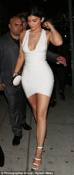 This old thing? Kylie's petite curves looked amazing in the snug and very tiny white dress, that made the most of her lovely long legs